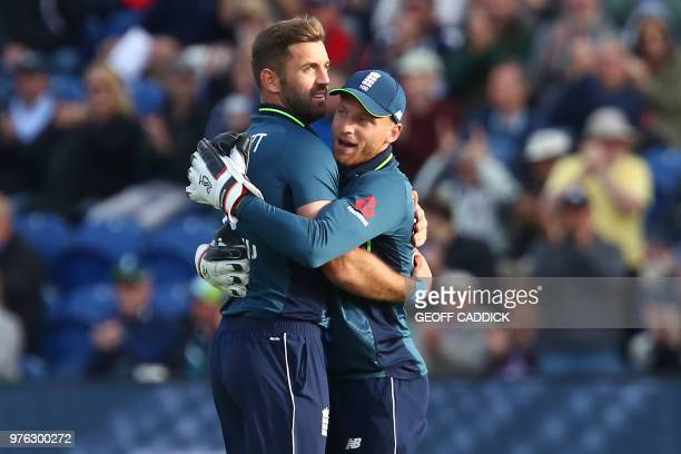 England's Liam Plunkett celebrates with England's Jos Buttler after bowling Australia's Shaun Marsh during play in the 2nd One Day International...