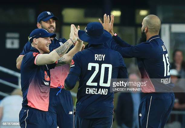 England's Liam Plunkett celebrates with team mates the wicket of South Africa batsman AB De Villiers during the first OneDay International between...