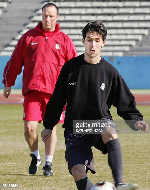 England's Liverpool FC Spanish midfielder Luis Garcia takes a pass training for the World Club Championships in Kawasaki 16 December 2005 while...