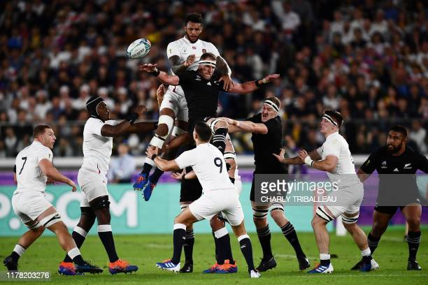 England's lock Courtney Lawes and New Zealand's number 8 Kieran Read jump for the ball during the Japan 2019 Rugby World Cup semi-final match between...