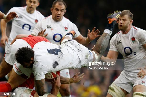 TOPSHOT England's lock Courtney Lawes tackles Wales' prop Tomas Francis during the Six Nations international rugby union match between Wales and...