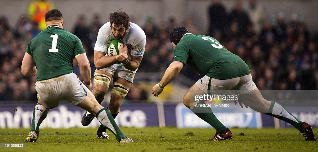England's lock Geoff Parling (C) tries to break through the line of Ireland's prop Cian Healy (L) and Ireland's prop Mike Ross (R) during the Six Nations international rugby union match between Ireland and England at the Aviva Stadium in Dublin on February 10, 2013. England won the game 12-6.