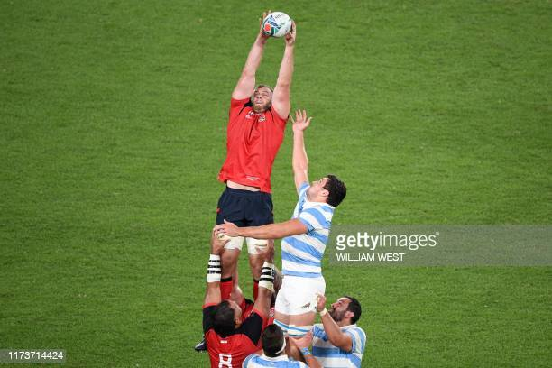 England's lock George Kruis catches the line-out ball during the Japan 2019 Rugby World Cup Pool C match between England and Argentina at the Tokyo...