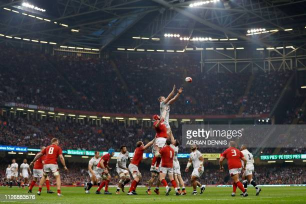 England's lock George Kruis jumps to win lineout ball during the Six Nations international rugby union match between Wales and England at the...
