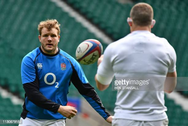 England's lock Joe Launchbury attends the captain's run training session at Twickenham stadium in south west London on March 15 on the eve of their...