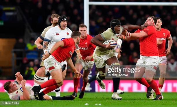 England's lock Maro Itoje hands off Wales' Wyn Jones during the Six Nations international rugby union match between England and Wales at the...
