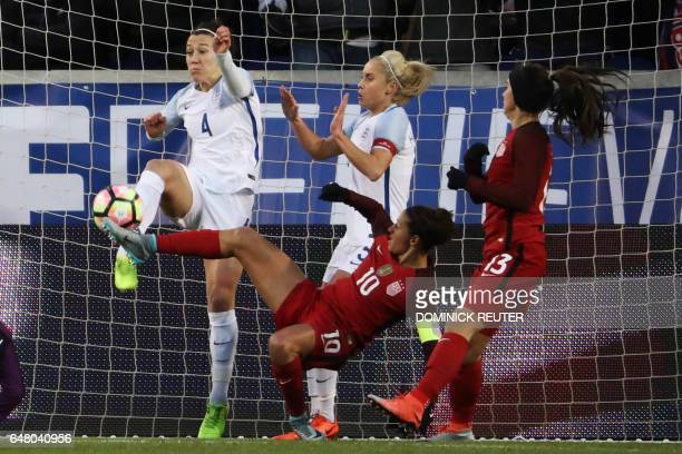 England's Lucy Bronze and United States' Carli Lloyd battle for the ball as the United States and England women's national teams play in the...