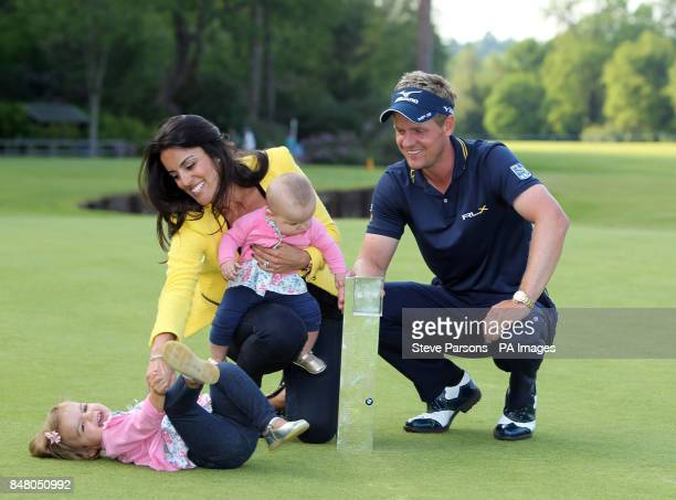 England's Luke Donald celebrates winning the BMW PGA Championship with his wife Diane Antonopoulos and his children Elle and Sophia at Wentworth Golf...