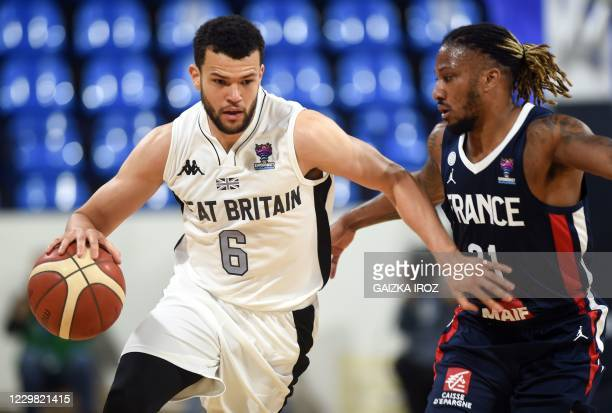 England's Luke Isaiah Nelson fights for the ball with France's Andrew Albicy during the Eurobasket 2020 basketball match France and England on...