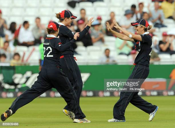 England's Lydia Greenway celebrates catching Sara McGlashan with Beth Morgan and captain Charlotte Edwards during the Final of the Womens ICC World...