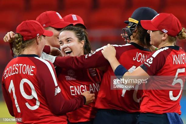 England's Mady Villiers celebrates her wicket of West Indies' Shemaine Campbelle with teammates during the Twenty20 women's World Cup cricket match...