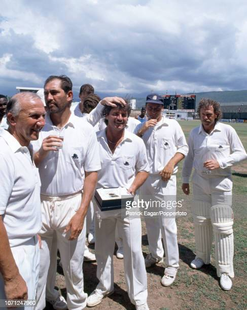 England's man of the match Allan Lamb celebrates with his teammates after England won the 1st Test match between West Indies and England at Sabina...