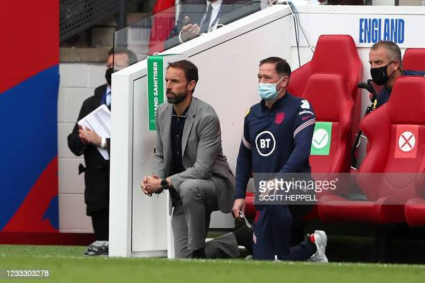 England's manager Gareth Southgate and Steve Holland, Assistant Coach of England 'take a knee' ahead of the international friendly football match...
