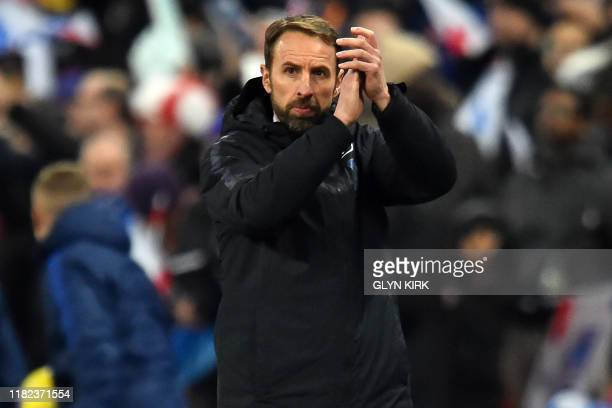 England's manager Gareth Southgate applauds supporters after the UEFA Euro 2020 qualifying first round Group A football match between England and...