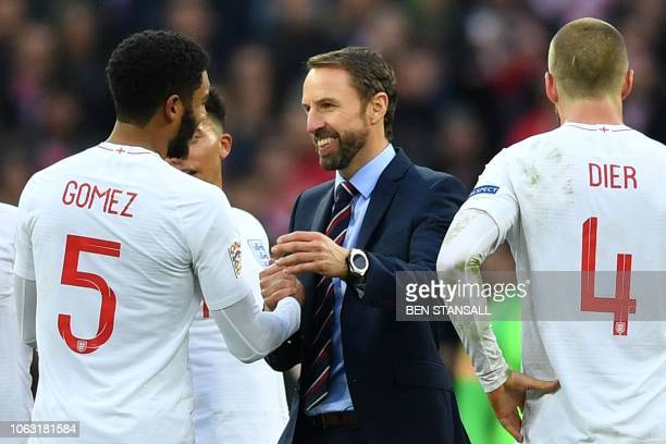 England's manager Gareth Southgate congratulates England's defender Joe Gomez on the pitch after the international UEFA Nations League football match...