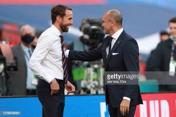 England's manager Gareth Southgate greets Belgium's coach Roberto Martinez before the UEFA Nations League group A2 football match between England and...