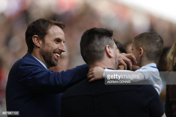 England's manager Gareth Southgate is pictured with 5 yearold mascot Bradley Lowery ahead of the World Cup 2018 qualification football match between...