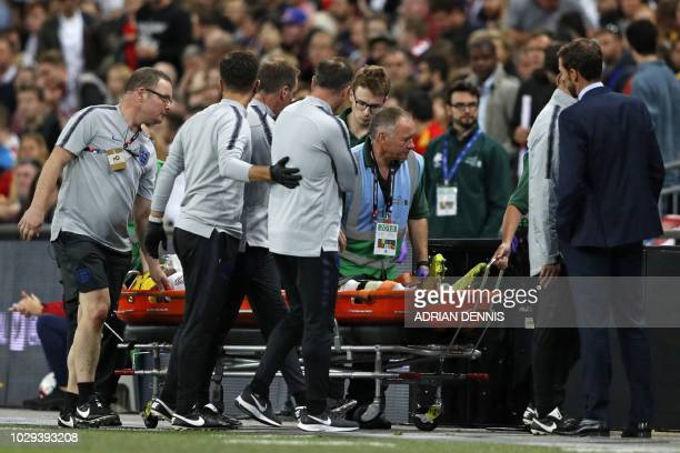 England's manager Gareth Southgate looks on as England's defender Luke Shaw is taken off on a stretcher after picking up an injury during the UEFA...