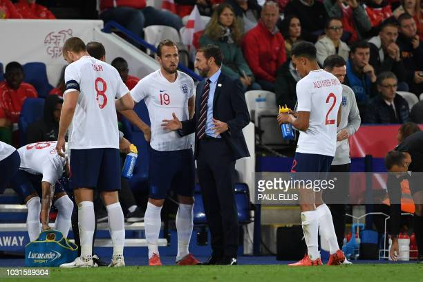England's manager Gareth Southgate speaks to England's striker Harry Kane during a friendly international football match between England and...