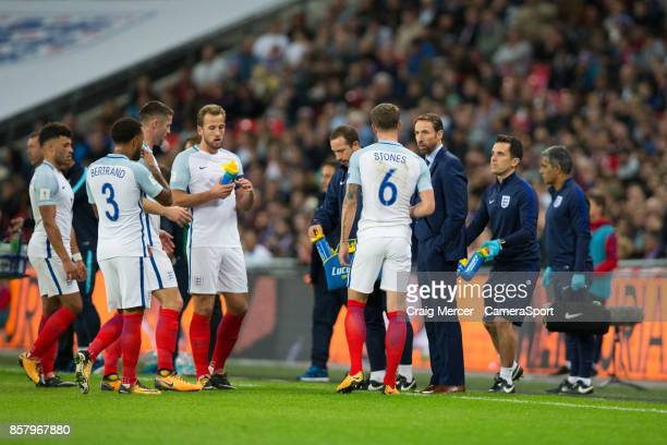 Englands manager Gareth Southgate talks to John Stones during the FIFA 2018 World Cup Qualifier between England and Slovenia at Wembley Stadium on...