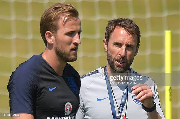 England's manager Gareth Southgate talks with England's striker Harry Kane during a training session at St George's Park in Burton-on-Trent on May 22...