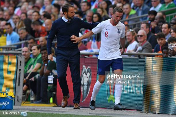 England's manager Gareth Southgate tlaks with England's midfielder Jordan Henderson as he is substituted off during the UEFA Euro 2020 qualifying...