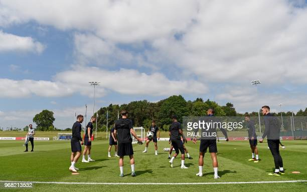 England's manager Gareth Southgate watches his players pass the ball during a open training session at St George's Park in BurtononTrent on June 6...