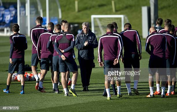 England's manager Roy Hodgson conducts a training session at St George's Park near BurtononTrent central England on October 8 ahead of their UEFA...