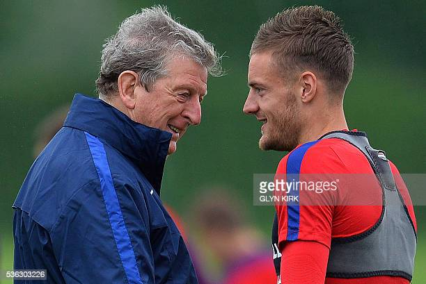 England's manager Roy Hodgson reacts as he talks with England's striker Jamie Vardy during a team training session in Watford north of London on June...
