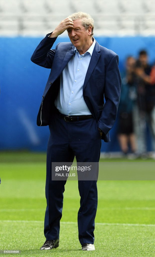England's manager Roy Hodgson stands on the pitch in Lens, France on June 15, 2016 during a pitch walkabout of the Euro 2016 football tournament. England prepares to face Wales on June 16, 2016. / AFP / PAUL