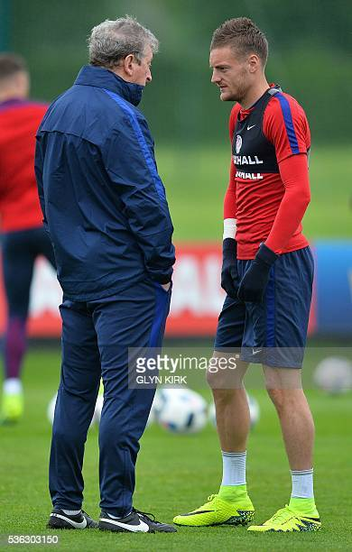England's manager Roy Hodgson talks with England's striker Jamie Vardy during a team training session in Watford north of London on June 1 2016...