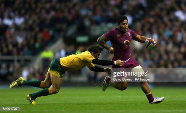 England's Manu Tuilagi is tackled by Adam AshleyCooper of Australia during the QBE International at Twickenham London