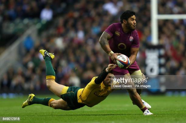 England's Manu Tuilagi is tackled by Australia's Adam AshleyCooper during the QBE International at Twickenham London