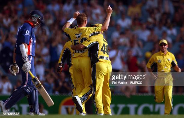 England's Marcus Trescothick walks off after being caught by Australia's Andy Bichel off the bowling of Brett Lee