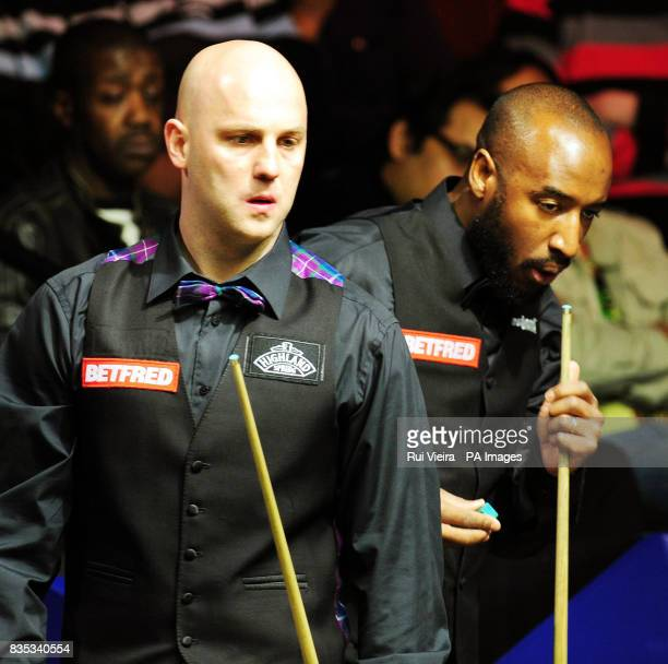 England's Mark King with England's Rory McLeod during the Betfredcom World Snooker Championship at The Crucible Theatre Sheffield