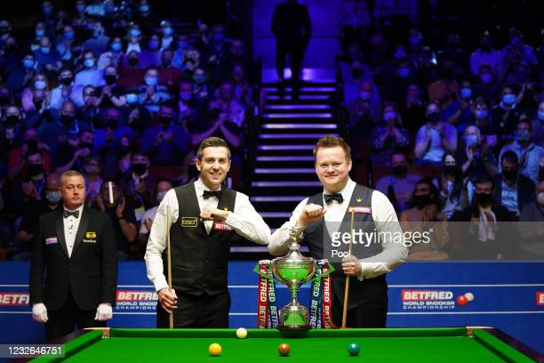 England's Mark Selby and England's Shaun Murphy bump elbows before the start of the Betfred World Snooker Championship Final at Crucible Theatre on...