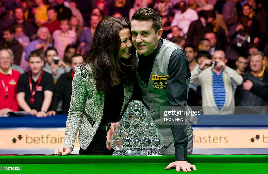 England's Mark Selby and his wife Vikki Layton pose with the ...