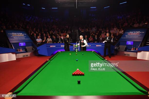England's Mark Selby and Scotland's John Higgins shake hands ahead of the final session of the World Championship Snooker final match at The Crucible...
