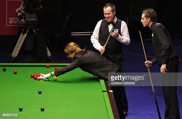 England's Mark Selby and Scotland's John Higgins watch as Referee Michaela Tabb looks for a touching ball during the Masters Snooker semifinal match...