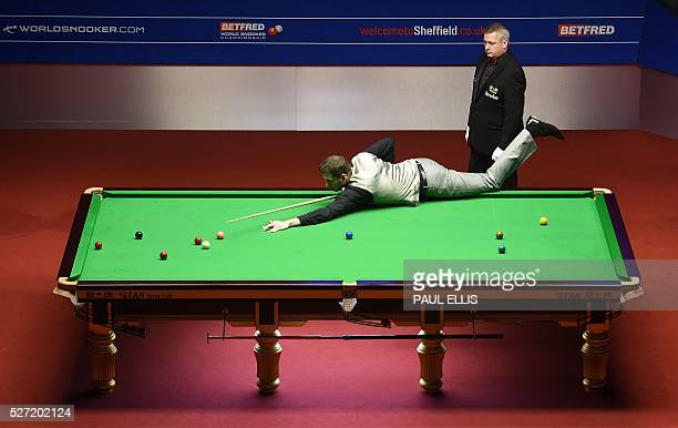 England's Mark Selby plays a shot during the third session of the World Snooker Championship final against China's Ding Junhui at the Crucible...