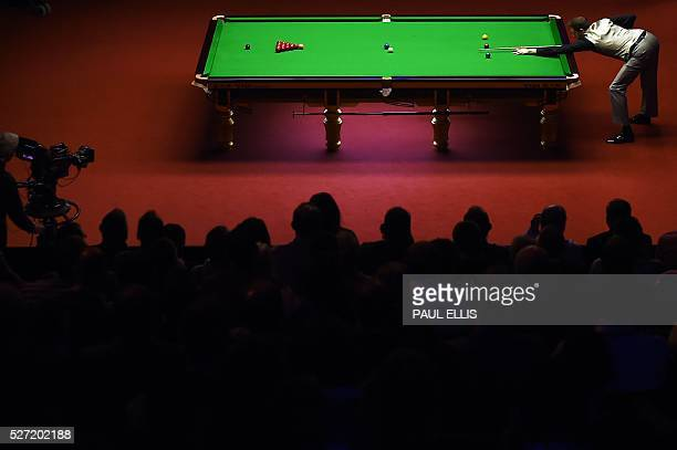 TOPSHOT England's Mark Selby plays a shot during the third session of the World Snooker Championship final against China's Ding Junhui at the...