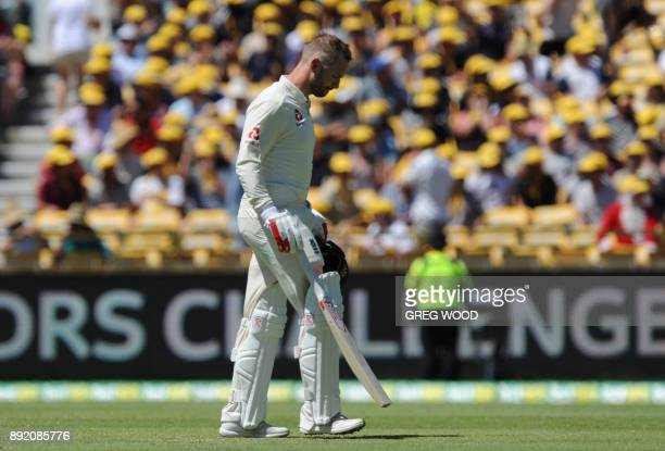 England's Mark Stoneman leaves the field after a controversial dismissal on day one of the third Ashes cricket Test match against Australia in Perth...