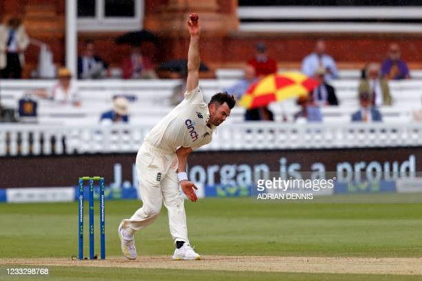 England's Mark Wood bowls in the light rain on the fifth day of the first Test cricket match between England and New Zealand at Lord's Cricket Ground...