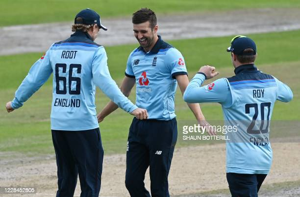 England's Mark Wood celebrates dismissing Australia's Aaron Finch during the one-day international cricket match between England and Australia at Old...
