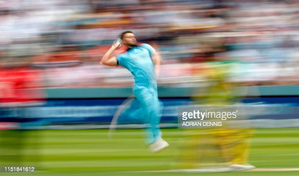 England's Mark Wood delivers a ball during the 2019 Cricket World Cup group stage match between England and Australia at Lord's Cricket Ground in...
