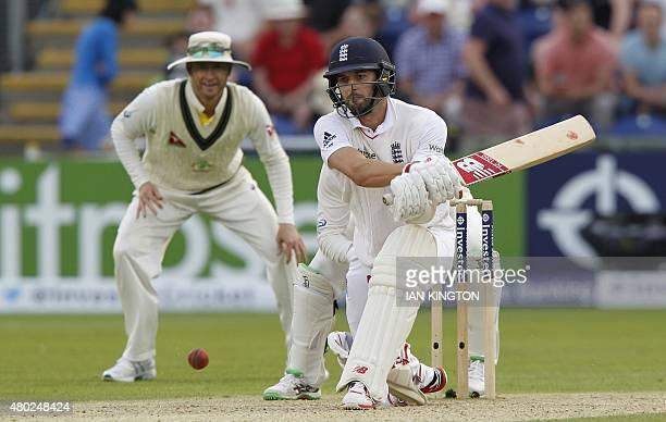 Englands Mark Wood hits a reverse sweep shot for 4 runs during play on the third day of the opening Ashes cricket test match between England and...
