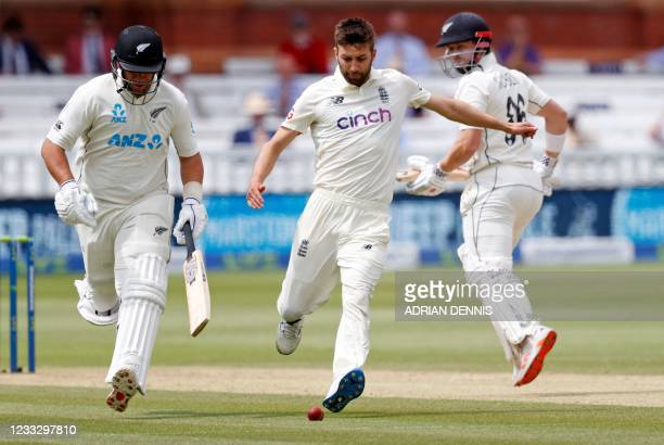 England's Mark Wood kicks the ball towards the stumps as New Zealand's Ross Taylor runs back to his crease on the fifth day of the first Test cricket...