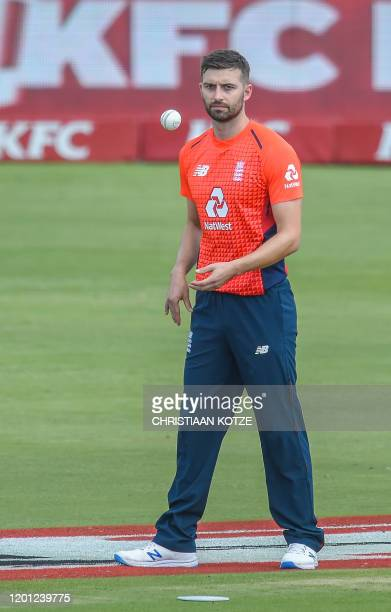 England's Mark Wood prepares to bowl during the third and final Twenty20 international cricket match between South Africa and England at the Super...