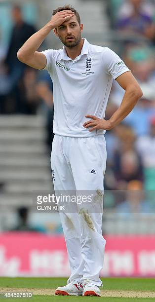 England's Mark Wood reacts after bowling during the first day of the fifth Ashes cricket Test match between England and Australia at the Oval in...