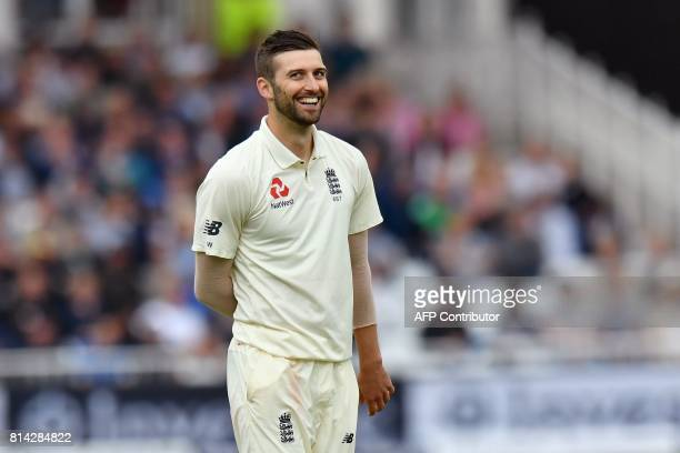 England's Mark Wood smiles after striking South Africa's Heino Kuhn with a bouncer from during play on the first day of the second Test Match between...